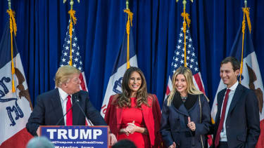 Jared Kushner stands with his wife's family at a rally.