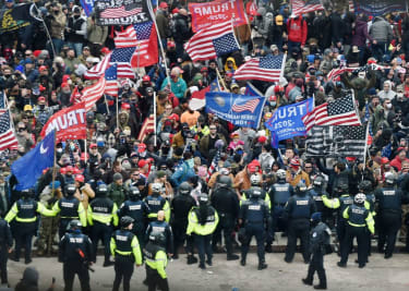 Trump supporters face off with police at the Capitol.