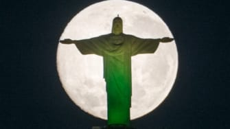 The supermoon looked absolutely chilling behind Brazil's giant Jesus statue