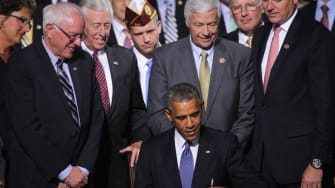 Obama signs the Veterans Choice Act