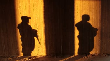 Shadows of Hamas security forces.