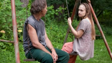 Jessa sits on a swing with her man-child of a dad.