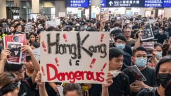 Protesters bring Hong Kong airport to a halt