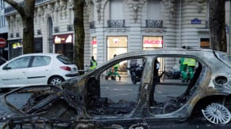 A burned car in a street of Paris on December 2, 2018, a day after clashes during a protest of Yellow vests (Gilets jaunes) against rising oil prices and living costs.