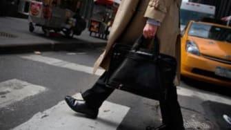 A man carries a briefcase