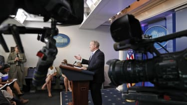 Cameras are pointed at Sean Spicer during an off-camera briefing on June 26.
