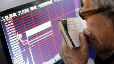 A Chinese investor tracks stocks on a screen.