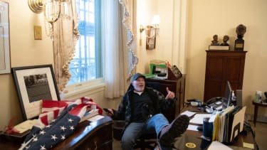 Richard Barnett inside Nancy Pelosi's office.