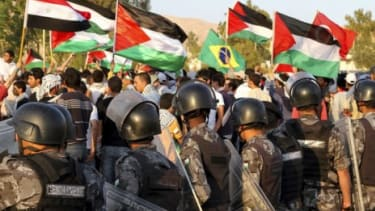 Palestinians wave flags during the commemoration Saturday of Israel's creation; the protest turned deadly after Israeli defense forces fired on demonstrators.