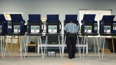 A man casts a ballot in Florida.