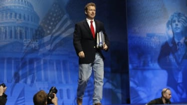Sen. Paul holds binders, a reference to his recent 13-hour filibuster, as he arrives to speak at CPAC March 14.