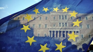 An EU flag flutters in front of the Greek parliament