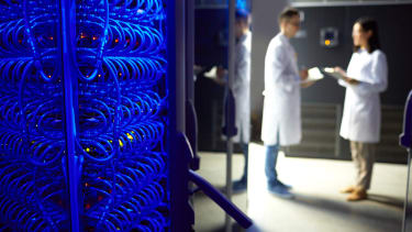 Two scientists in database center.