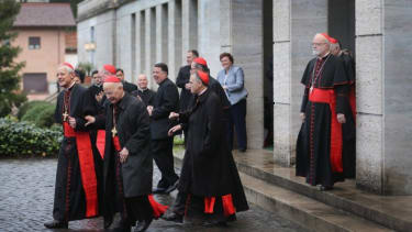 The cardinals head to mass on March 12 before entering the conclave to choose the next pope.