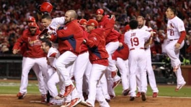 The St. Louis Cardinals celebrate their dramatic win over the Rangers in game six of the World Series.