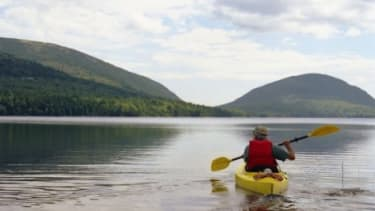 A man kayaks in Acadia National Park: The annual United State Peace Index ranks Maine as our nation's most peaceful state.