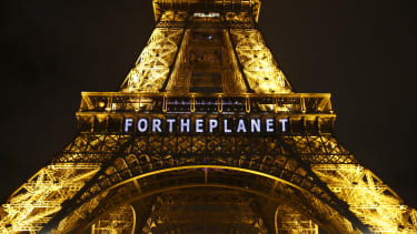 The Eiffel Tower is lit up for the climate conference in Paris.