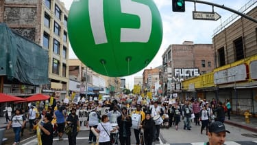 Protesters call for a minimum wage of $15 an hour.