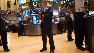 A stock trader works the floor of the New York Stock Exchange on April 23.