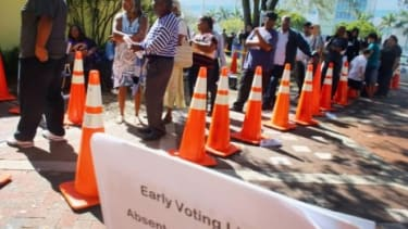 People wait in line to vote at the North Miami Public Library in Miami, Fla., on Nov. 1.