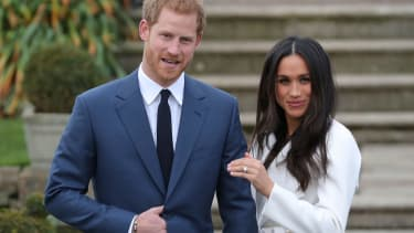 Prince Harry stands with his fiancée US actress Meghan Markle.
