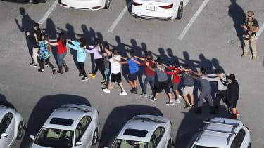 Students leave Marjory Stoneman Douglas High School
