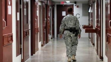 A guard walks through a cellblock on March 5 inside Camp V, Guantanamo Bay.