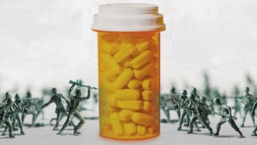 Toy soldiers and a pill bottle.
