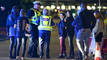 Police talk with people who escaped from the Manchester Arena.