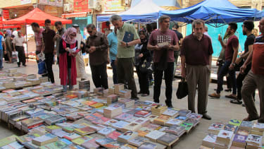 People in Baghdad buy books to donate to Mosul.