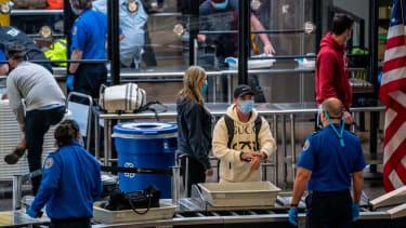 A traveler going through airport security.
