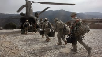 Soldiers boarding helicopter.