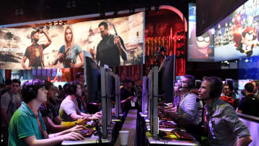 Gamers play the Ubisoft 'Rainbow Siege' game at E3 2017.