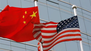 Chinese and American flags wave in Beijing