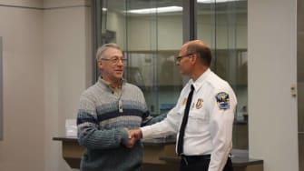 Earl Melchert, left, and Alexandria, MN police chief, Richard Wyffels, right.