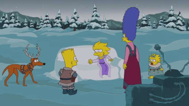 The Simpsons' Christmas opening credits include 'obligatory Frozen' gag