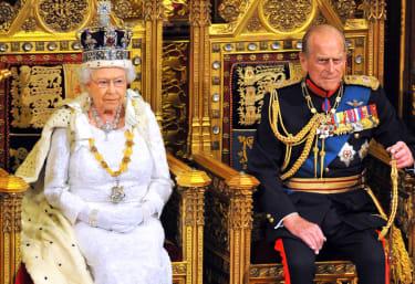 Queen Elizabeth II sits with Prince Philip.
