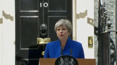 Prime Minister Theresa May will form a government despite her party facing a bruising loss.