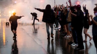Tear gas is fired at protesters.