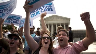 ObamaCare supporters celebrate Thursday after the Supreme Court rules that the bulk of President Obama's health-care overhaul is constitutional.