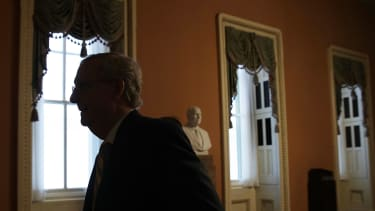 Mitch McConnell returns to his office at the Capitol