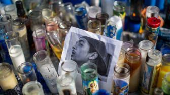 Candles at a memorial for Nipsey Hussle in Los Angeles.