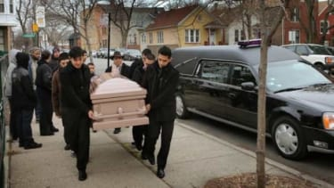 Pallbearers carry the body of 14-year-old Chicagoan Rey Dorantes, who was shot six times on his front porch on Jan. 11.