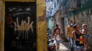 Bullet holes in a doorway in Rio's Jacarezinho favela.