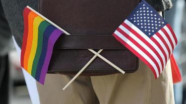 LGBT flag alongside a US flag