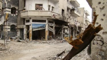Syrian President Bashar al-Assad has reportedly agreed to pull his troops out of battered rebel strongholds like Homs (pictured) and Idlib.