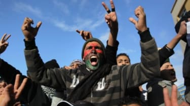 Rebels (pictured) have gained control of much of Eastern Libya, and the U.S. is reportedly concerned that Moammar Gadhafi would deploy chemical weapons on them before letting Tripoli fall.