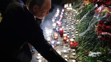 Russian President Vladimir Putin visits a memorial in St. Petersburg