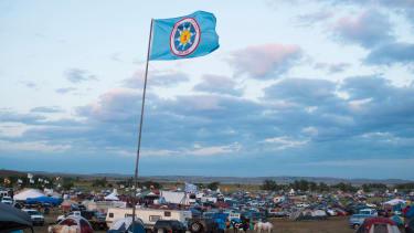 A Standing Rock Sioux flag flies over a protest encampment near Cannon Ball, North Dakota
