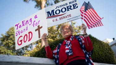 A woman supports Roy Moore